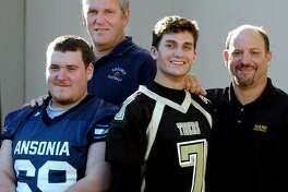 Jeff Hunt and his dad Ansonia football coach Jack Hunt pose with fellow father son duo, and Kevin Filippone and his dad, Hand High School football coach Steve Filippone in 2005. On Friday, the practice field at Jarvis Field in Ansonia will officially be named the Jack Hunt Memorial Practice Field.
