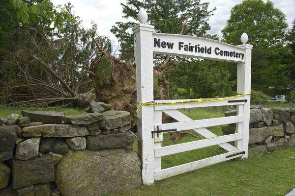 New Fairfield Cemetery, on Brush Hill Road, has a number of trees that were damaged or blown over in last month's storm. Wednesday, June 6, 2018, in New Fairfield, Conn.