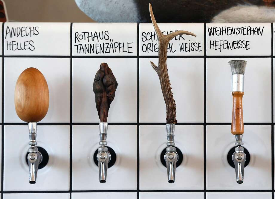 Every tap handle has a unique shape at Radhaus, which offers eight German beers plus one local ale, a cider and a kombucha. Photo: Photos By Paul Chinn / The Chronicle