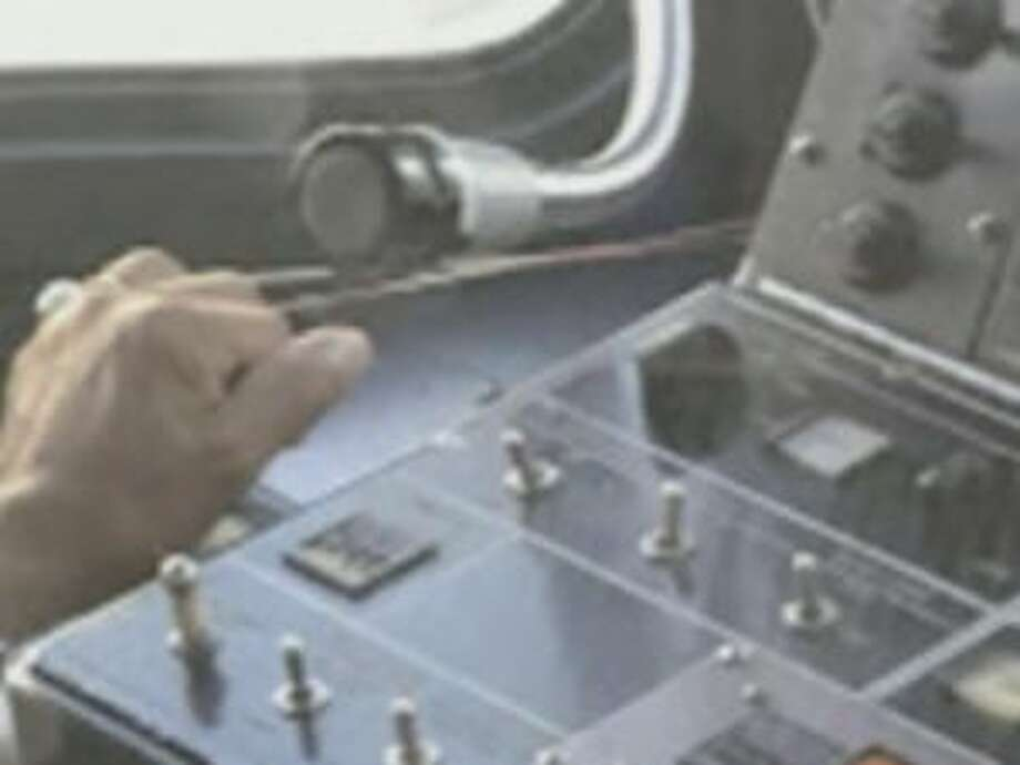 A Muni light rail operator was photographed using a rubber band to keep the train throttle in place, an apparent violation. Photo: KTVU Screen Shot