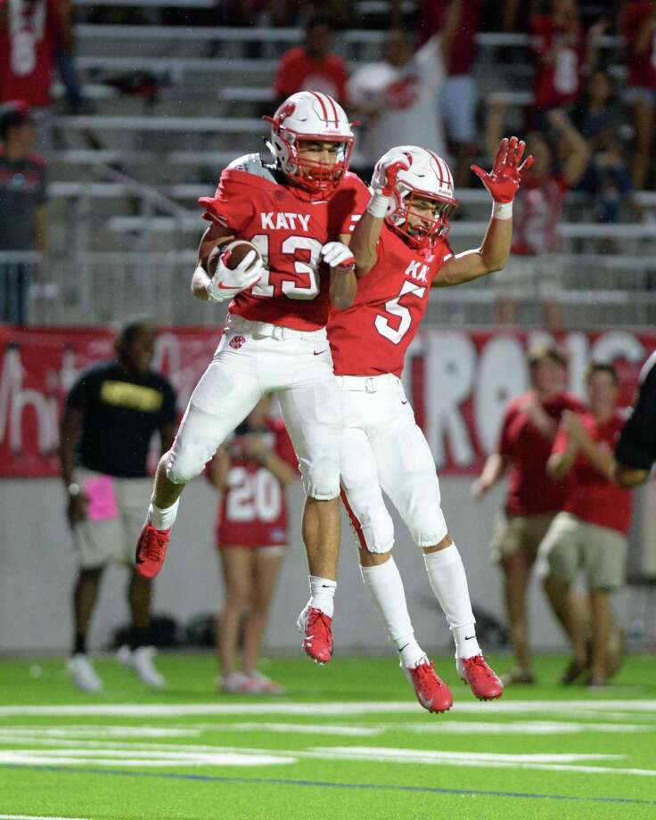 Jordan Patrick (13) and Steven Stiles (5) of Katy celebrate a reception that set-up a tying touchdown on the next play during the fourth quarter. Photo: Craig Moseley, Houston Chronicle / Staff Photographer / ©2018 Houston Chronicle