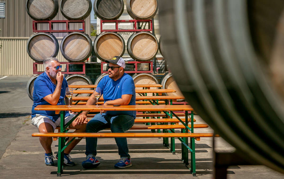People taste wine at Donkey and Goat Winery in Berkeley, Calif. on August 25th, 2018.