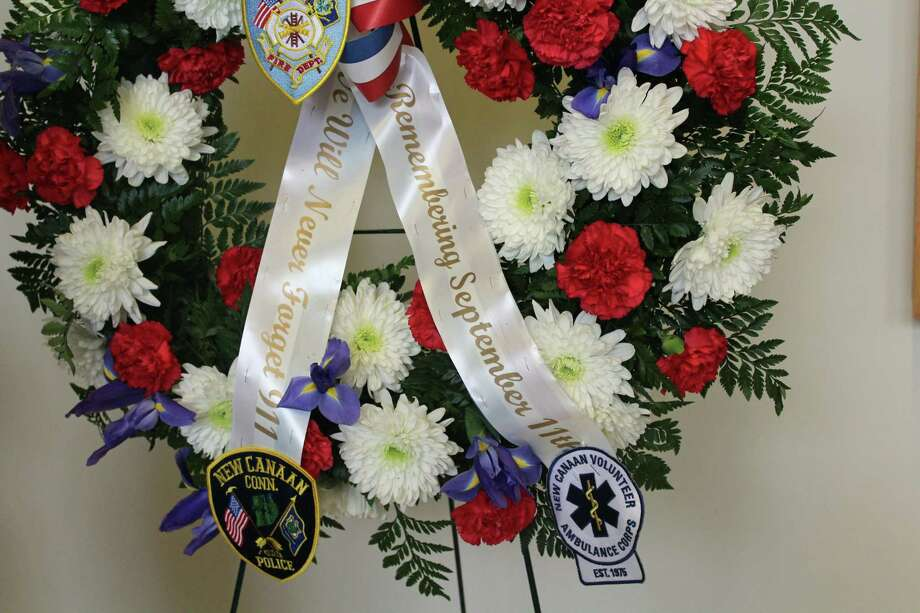 Wreath in honor of 9/11 and the three New Canaan residents who perished in the attack. Photo: Humberto J. Rocha / Contributed Photo / New Canaan News contributed