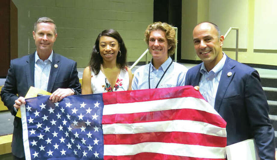 Congressmen Rodney Davis, left, and Jimmy Panetta, right, presented a flag to Edwardsville High School seniors Amber Harris and Roland Prenzler. The flag was flown over the United States Capitol. Photo: Carol Arnett/Intelligencer
