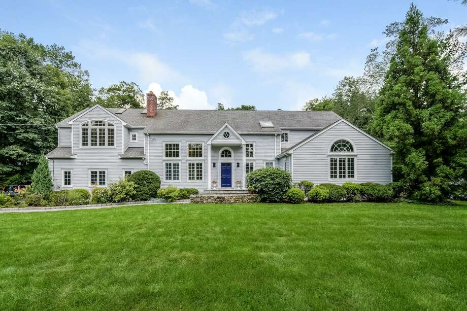 The large gray house with the royal blue door sits on a one-acre level and secluded property in the 'South of the Y' neighborhood.