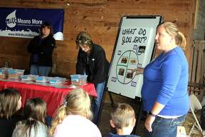 Huron County third graders were treated Tuesday to Project RED (Rural Education Day) at the Huron Community Fairgrounds. Sponsored by Huron County Farm Bureau, the day featured numerous demonstrations about local agriculture.