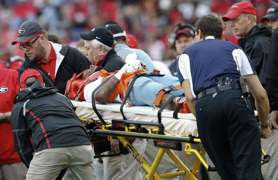 Southern wide receiver Devon Gales (33) is taken off the field after he was injured in a violent collision during a blowout win by Georgia in 2015. Photo: John Bazemore / Associated Press 2015 / AP