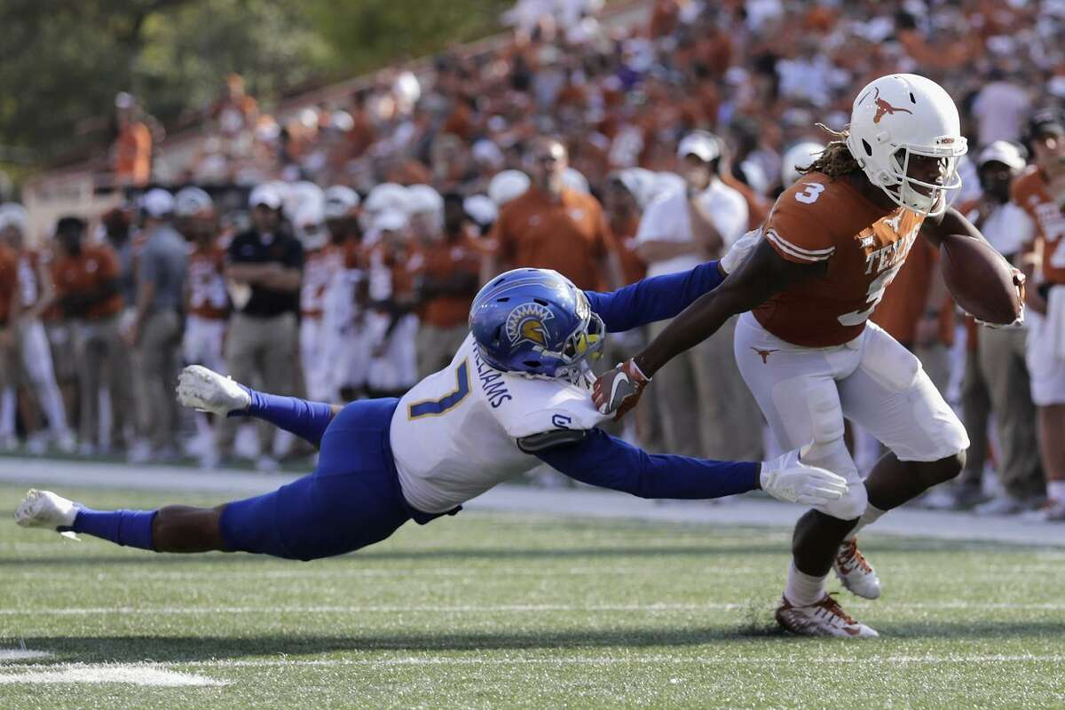 Armanti Foreman of Texas breaks free in last year's 56-0 revenue game over San Jose State, played in Austin, Texas. Every year, dozens of absurb mismatches appear on the schedule.