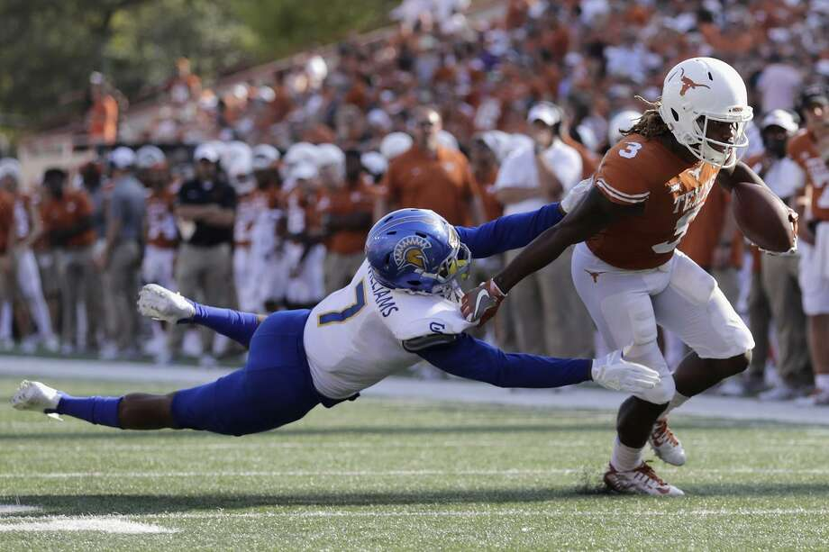 Armanti Foreman of Texas breaks free in last year's 56-0 revenue game over San Jose State, played in Austin, Texas. Every year, dozens of absurb mismatches appear on the schedule. Photo: Tim Warner / Getty Images / 2017 Getty Images