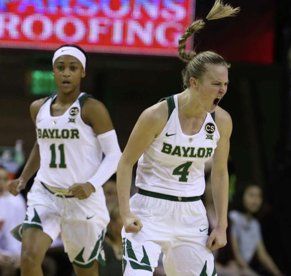 Baylor guard Kristy Wallace, right, reacts after scoring against Texas, next to guard Alexis Morris duringthe first half of an NCAA college basketball game, Thursday, Jan. 25, 2018, in Waco, Texas. (AP Photo/Rod Aydelotte)