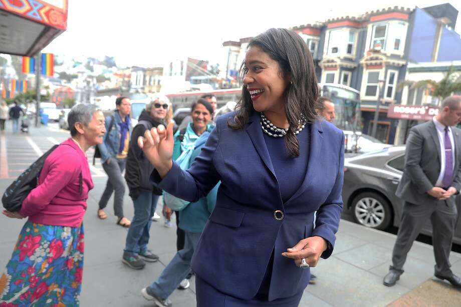 SF Mayor London Breed (right) talks with people in front of the Castro theatre as she takes a walk this morning around the Castro on Monday, Aug. 13, 2018 in San Francisco, Calif. Photo: Liz Hafalia, The Chronicle