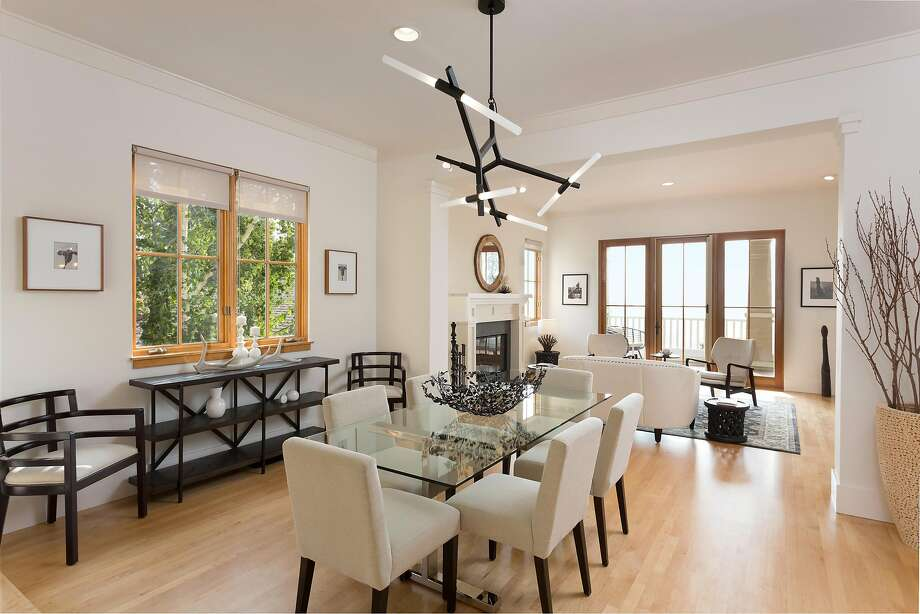The dining area at 115 Taurus Ave. in Oakland segues into a living room with a gas fireplace. Photo: Liz Rusby / Grubb Co.