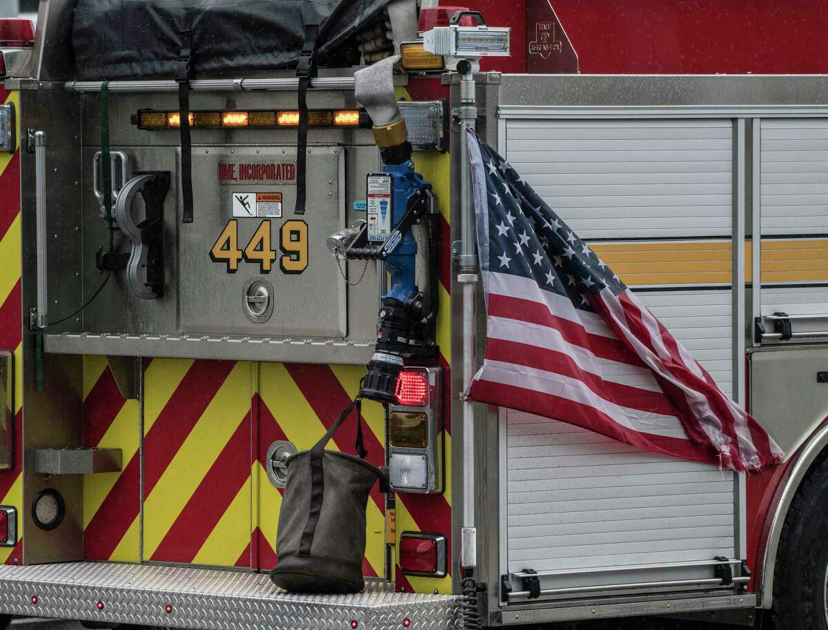 449 Engine of the Shaker Road Loudonville Fire Department shows off its patriotism on 9/11 Day on Shaker Road Tuesday Sept. 11, 2018 in Colonie, N.Y. (Skip Dickstein/Times Union)