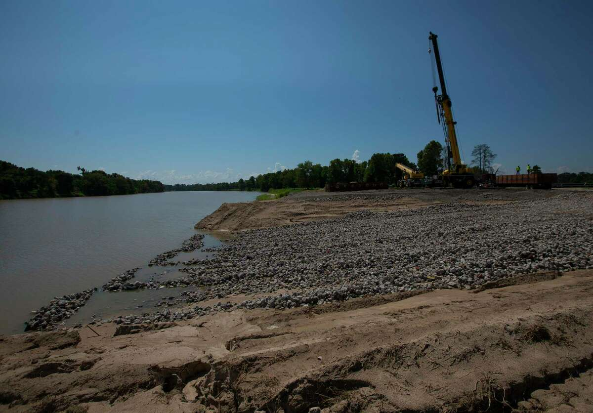 A ramp is built as contractors stage equipment for the Army Corps of Engineers' planned dredging of the West Fork of the San Jacinto River east of Highway 59, Wednesday, Aug. 1, 2018 in Humble.