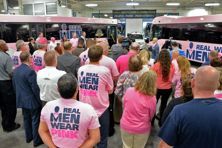 "Capital District Transportation Authority employees and supporters gather as CEO Carm Basile announces CDTA's ""Going Pink"" campaign during a news conference Tuesday Sept. 11, 2018 in Albany, NY. As part of the initiative, pink buses will be rolled out on Capital Region Streets to raise awareness of breast cancer and support the campaign. (John Carl D'Annibale/Times Union) Photo: John Carl D'Annibale, Albany Times Union / 20044786A"