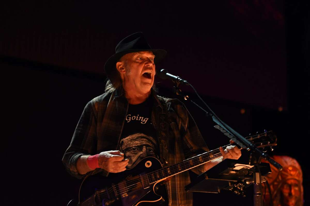 Neil Young belts out a tune at Farm Aid.