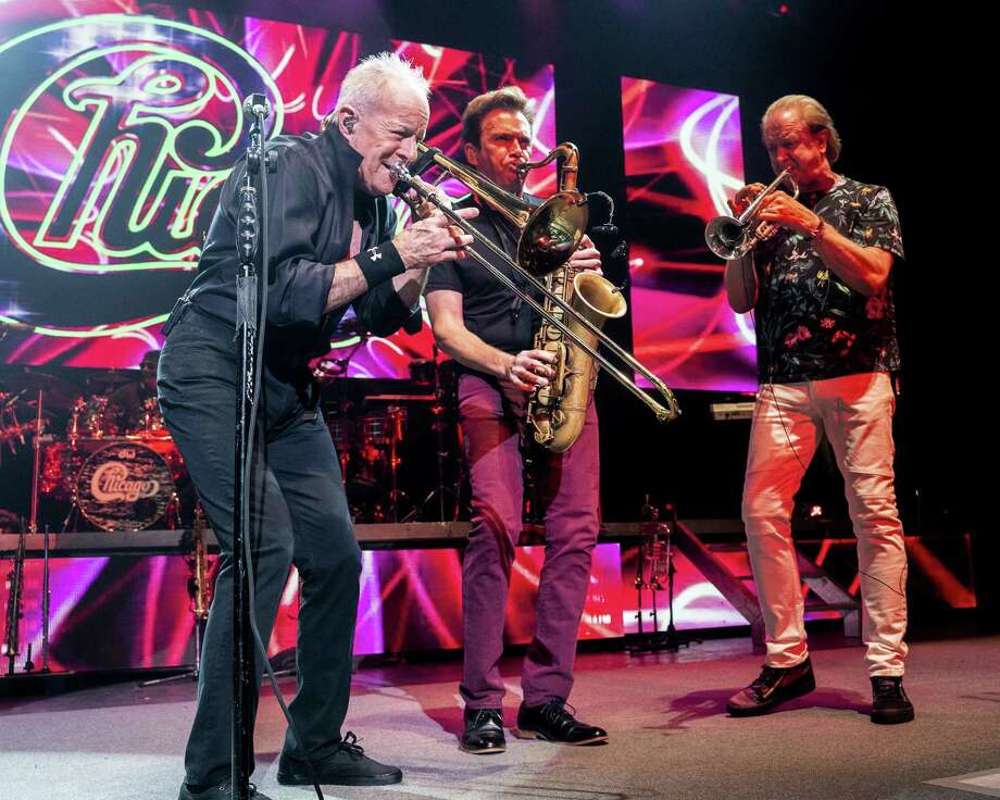 Trombone player James Pankow, saxophone player Ray Herrmann and trumpet player Lee Loughnane perform in August in Mansfield, Mass. Photo: Robert E. Klein / Invision/AP / 2018 Invision