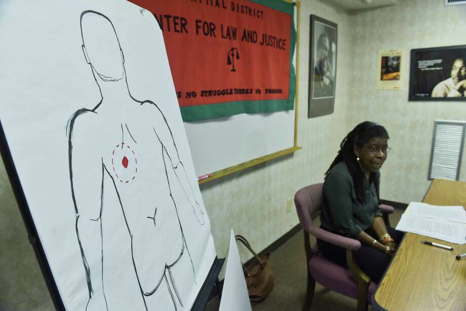 Alice Green, executive director of the Center for Law and Justice, talks to members of the media about the Albany Police Department's report on the shooting of Ellazar Williams, on Tuesday, Sept. 11, 2018, in Albany, N.Y. The drawing on the left is what Green says shows the area where Williams was shot in the back.   (Paul Buckowski/Times Union) Photo: Paul Buckowski, Albany Times Union / (Paul Buckowski/Times Union)