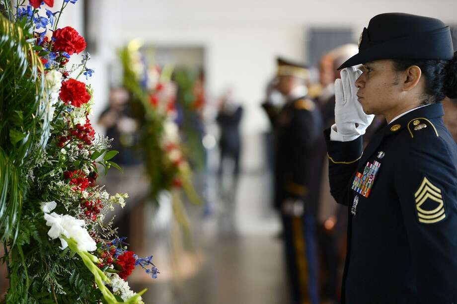 Master Sgt. Marleen Watson of the Army's 842nd Transportation Battalion presents a wreath during a memorial event at The Event Centre to the Sept. 11, 2001 terror attacks on Tuesday. Three wreaths were laid, representing the plane crashes in New York, the Pentagon and Pennsylvania.   Photo taken Tuesday 9/11/18  Ryan Pelham/The Enterprise Photo: Ryan Pelham / The Enterprise / ©2018 The Beaumont Enterprise