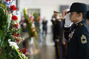 Master Sgt. Marleen Watson of the Army's 842nd Transportation Battalion presents a wreath during a memorial event at The Event Centre to the Sept. 11, 2001 terror attacks on Tuesday. Three wreaths were laid, representing the plane crashes in New York, the Pentagon and Pennsylvania.   Photo taken Tuesday 9/11/18  Ryan Pelham/The Enterprise