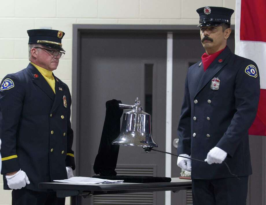 Rosendo Ortiz, a firefighter with The Woodlands Fire Department, rings a bell in honor of fallen emergency personnel during a ceremony in honor of Patriot Day at The Woodlands Central Fire Station on Tuesday, Sept. 11, 2018, in Spring. The event was held in remembrance of the nearly 3,000 victims of the terror attacks on September 11, 2001. Photo: Jason Fochtman, Houston Chronicle / Staff Photographer / © 2018 Houston Chronicle