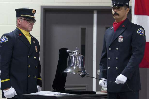 Rosendo Ortiz, a firefighter with The Woodlands Fire Department, rings a bell in honor of fallen emergency personnel during a ceremony in honor of Patriot Day at The Woodlands Central Fire Station on Tuesday, Sept. 11, 2018, in Spring. The event was held in remembrance of the nearly 3,000 victims of the terror attacks on September 11, 2001.
