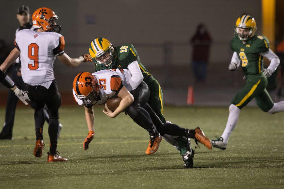 Dow High's Nick Sierocki tackles Fenton quarterback Dylan Crankshaw during a 2016 playoff game. Photo: Daily News File Photo