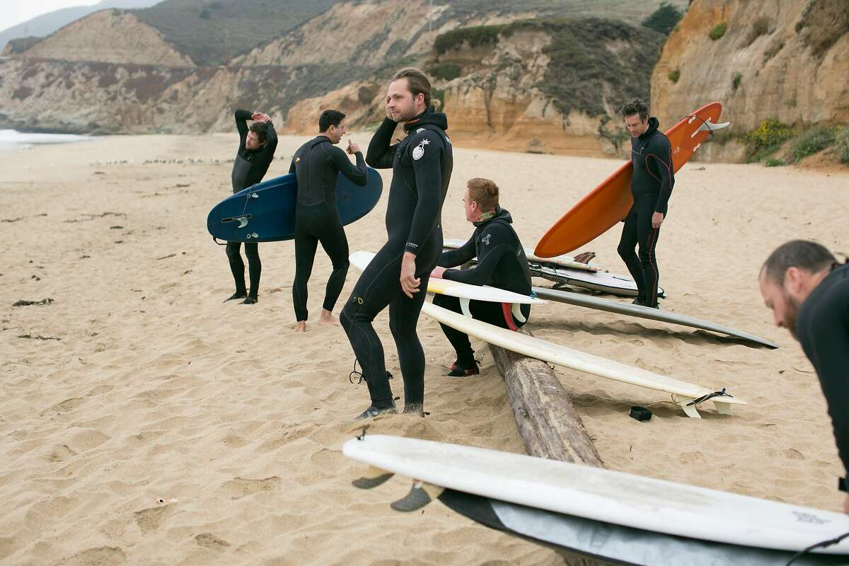 Friends and chefs from around the Bay Area get together to surf at Montara State Beach in Montara, Calif. on Monday, August 28, 2018.