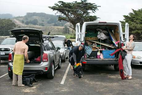 Jason Alexander, restaurant director at the Progress and State Bird Provisions (from left); Matt Kosoy, owner of Rosalind Bakery; and Scott Clark, chef-owner of Dad's Luncheonette, get into their wetsuits at Montara State Beach in Montara. Photo: Brian Feulner / Special To The Chronicle