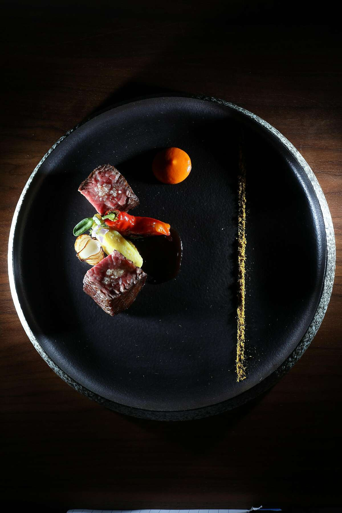 Yemenite-style beef ribeye - matbucha, cipollini onion, white yam- from course five of Michael Mina's 6 course menu is seen on Friday, September 7, 2018 in San Francisco, Calif.