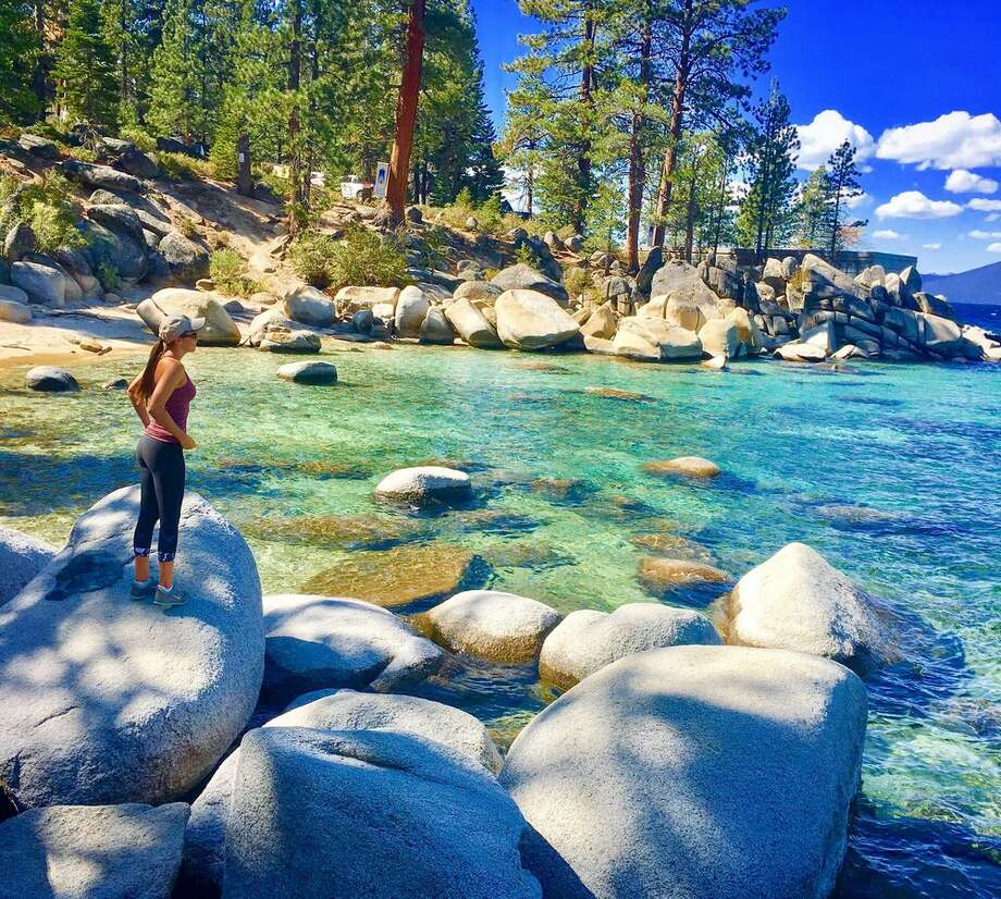 """""""The (hotel) properties that will recover the fastest are those that are located in drive-to markets"""" such as Lake Tahoe. Pictured: Hidden Beach: This 750-foot-long beach flanked by boulders and lots of sand sandy sits right off Highway 28 but it's obscured by trees. It attracts crowds at the height of summer, but because you have to park about a mile away and hike in, this eliminates some people. Photo: Lexie E. / Yelp"""