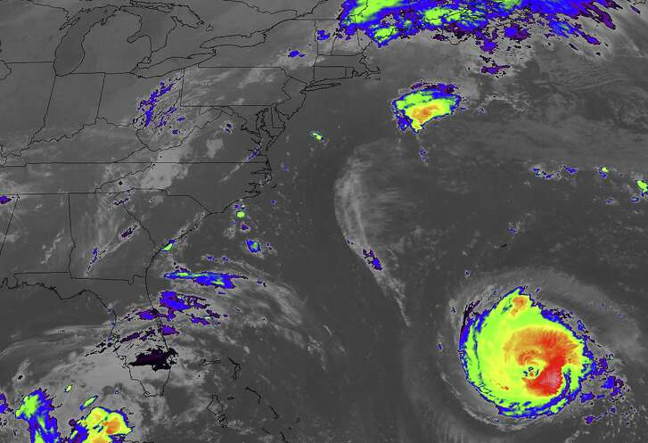 """This NASA infrared satellite shows an image of the Atlantic Ocean from the GOES 16 Advanced Baseline Imager of Hurricane Florence off the US east coast at 6:00 a.m. EST, on September 11, 2018. - Powerful Hurricane Florence headed toward the US East Coast Tuesday, prompting authorities to order more than a million people to evacuate the path of the extremely dangerous storm forecasters said could soon intensify. Residents scrambled to flee as the menacing Category 4 storm packing winds of 140 miles (220 kilometers) per hour moved closer.""""This is one of the worst storms to hit the East Coast in many years,"""" President Donald Trump warned on Twitter. """"Please be prepared, be careful and be SAFE!"""" (Photo by HO / NASA / AFP) / RESTRICTED TO EDITORIAL USE - MANDATORY CREDIT """"AFP PHOTO / NASA/HANDOUT"""" - NO MARKETING NO ADVERTISING CAMPAIGNS - DISTRIBUTED AS A SERVICE TO CLIENTSHO/AFP/Getty Images"""