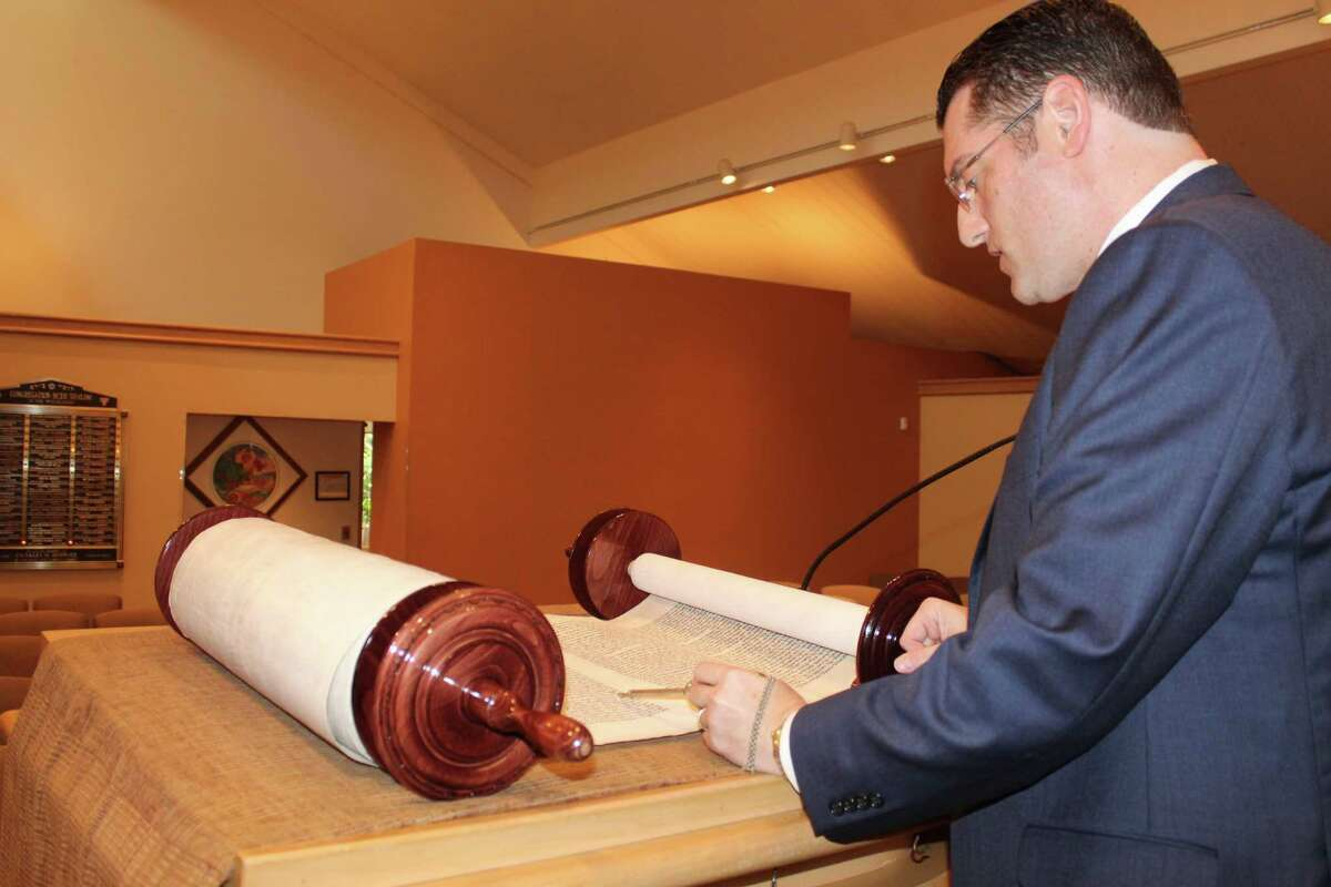 Rabbi Matthew Berger explains the Torah's significance for his congregation. Outside of the High Holy Days, the Torah is just as important. Berger reads from the Torah at weekly services and then gives a talk about how its message can apply to a congregant's daily life.