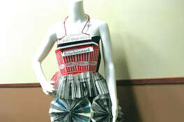 This dress has been made entirely from copies of the Edwardsville Intelligencer.