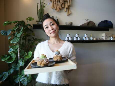 Pastry chef Mikiko Yui shows cream puffs at Stonemill Matcha. Photo: Liz Hafalia / The Chronicle