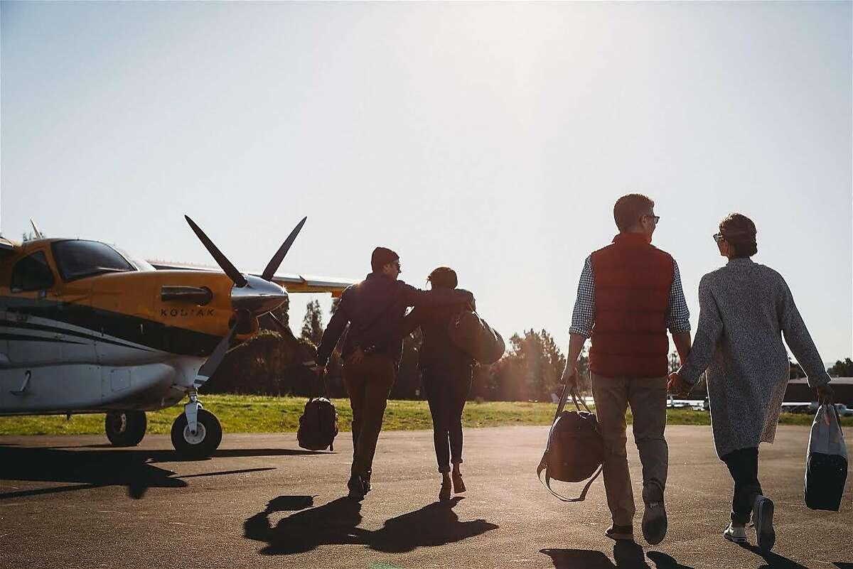 Passengers board a flight on Blackbird Air.