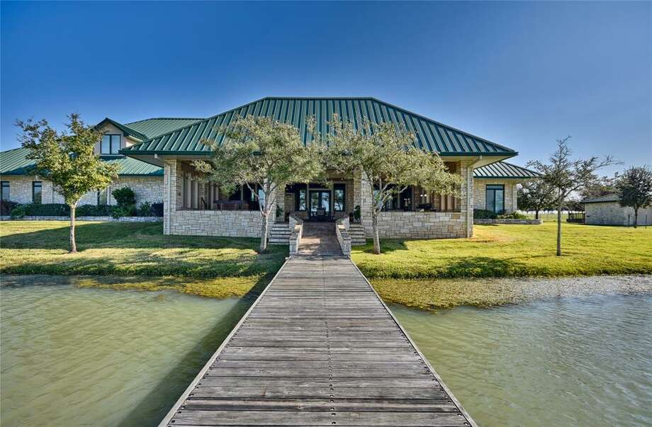 El Corazon Ranch - 23407 FM 362 Road, WallerList price: $13.95 millionFeatures: Four homes, 21-acre lake, barn apartment, barn for raising doves, high-fencing for exotic game. See the full listing. Photo: Cheryl Fowlkes/HAR.com