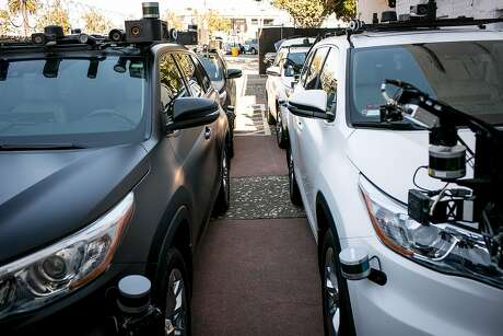 A fleet of Zoox autonomous cars are parked in a lot behind a Zoox office on Friday, Sept. 7, 2018 in San Francisco, Calif.