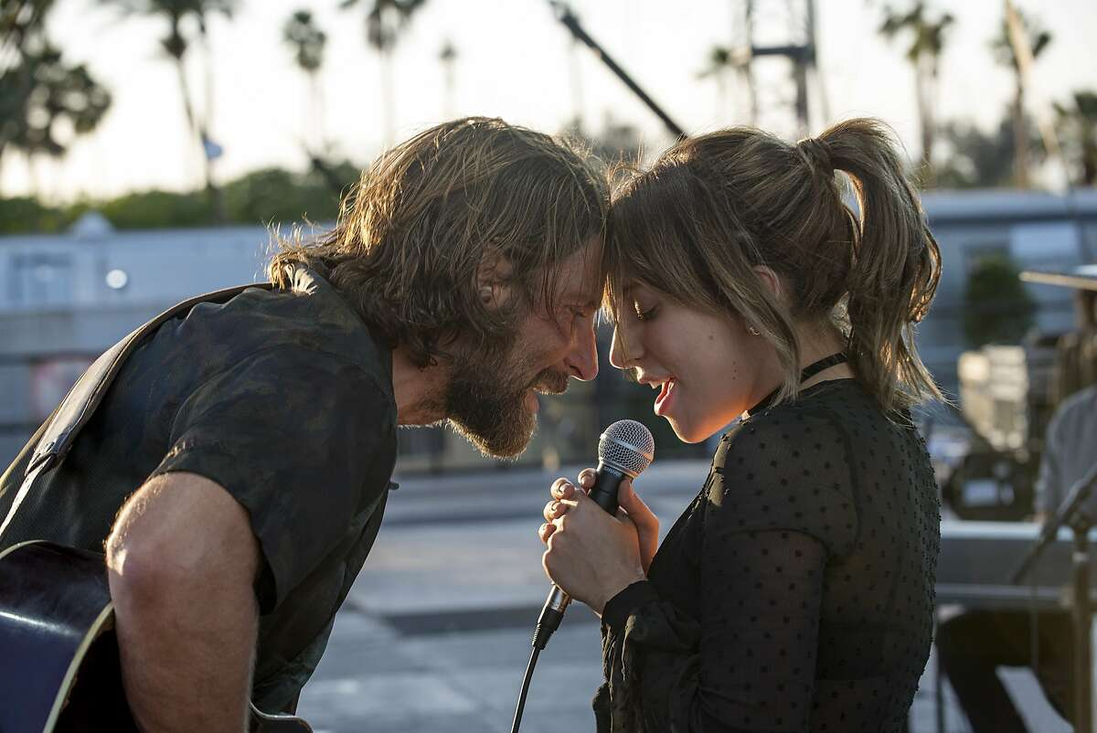 """This image released by Warner Bros. shows Bradley Cooper, left, and Lady Gaga in a scene from the latest reboot of the film, """"A Star is Born."""" (Neal Preston/Warner Bros. via AP)"""