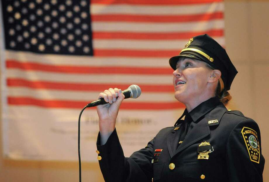 Police detective Kristina LePak sings the national anthem during Norwalk's annual Sept. 11 Remembrance on Tuesday. Photo: Erik Trautmann / Hearst Connecticut Media / Norwalk Hour