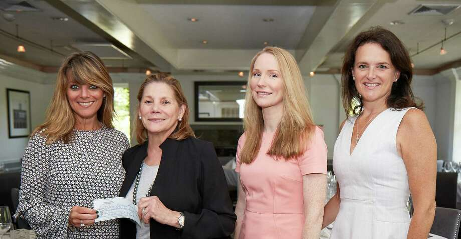 The Burton family not only made good on a promise to donate $1 million to the Greenwich based Breast Cancer Alliance they have exceeded their pledge. Last week, BCA Executive Director Yonni Wattenmaker, at left, was given a $50,000 check by Paula Burton, to her right, as they were joined by Calico Burton and BCA Board of Directors President Mary Jeffery. Photo: Contributed Photo / Contributed Photo / Connecticut Post Contributed