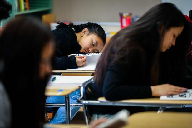 Makisha Brogan (center) puts her head on her desk as she listens during her european literature class at Phillip and Sala Burton High School in San Francisco, California, on Monday, Sept. 10, 2018.