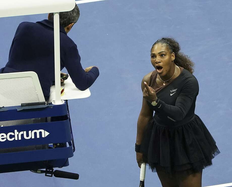 "FILE - In this Saturday, Sept. 8, 2018, file photo, Serena Williams argues with the chair umpire during a match against Naomi Osaka, of Japan, during the women's finals of the U.S. Open tennis tournament at the USTA Billie Jean King National Tennis Center,  in New York. Some black women say Serena Williams' experience at the U.S. Open final resonates with them. They say they are often forced to watch their tone and words in the workplace in ways that men and other women are not. Otherwise, they say, they risk being branded an ""Angry Black Woman."" (Photo by Greg Allen/Invision/AP, File) Photo: Greg Allen, Associated Press"