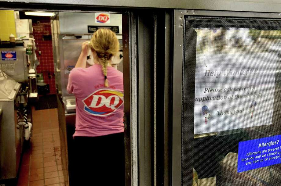 "In this Sunday, Aug. 19, 2018, file photo a woman prepares a cup of ice cream behind a ""Help Wanted"" sign at a Dairy Queen fast food restaurant in Rutherford, N.J. On Tuesday, Sept. 11, the Labor Department reports on job openings and labor turnover for July. Photo: Ted Shaffrey /Associated Press / ap"