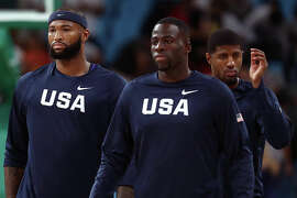 RIO DE JANEIRO, BRAZIL - AUGUST 19: Demarcus Cousins #12, Draymond Green #14 and Paul George #13 of United States warm up prior to the Men's Semifinal match against Spain on Day 14 of the Rio 2016 Olympic Games at Carioca Arena 1 on August 19, 2016 in Rio de Janeiro, Brazil.  (Photo by Ezra Shaw/Getty Images)