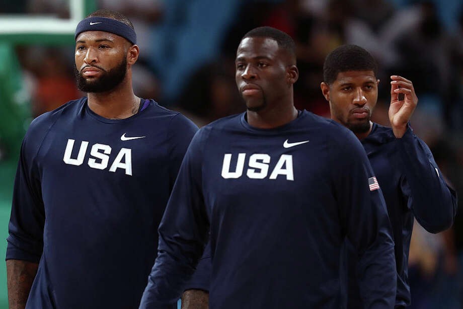 FILE -- Demarcus Cousins #12, Draymond Green #14 and Paul George #13 of United States warm up prior to the Men's Semifinal match against Spain on Day 14 of the Rio 2016 Olympic Games at Carioca Arena 1 on August 19, 2016 in Rio de Janeiro, Brazil. Cousins is now signed to the Warriors and it seems that he and Green are spending some time together before the Warriors season officially begins. Photo: Ezra Shaw/Getty Images / 2016 Getty Images