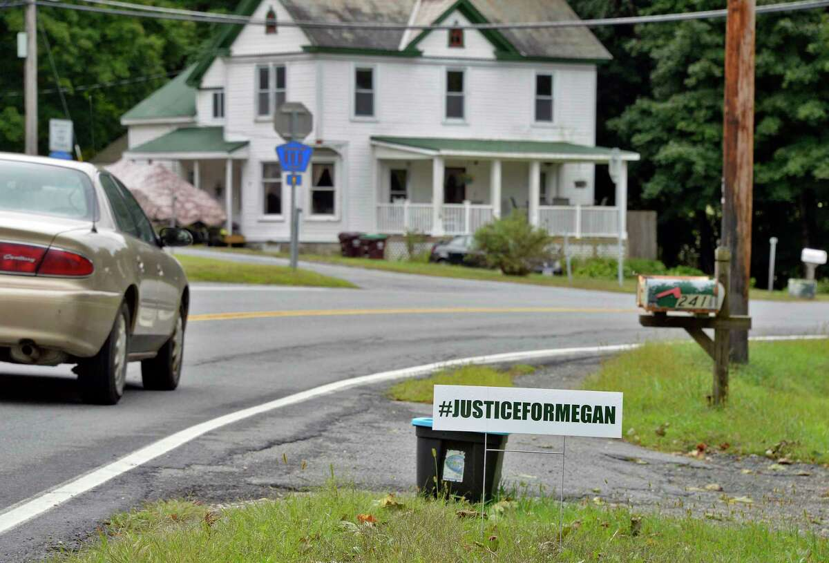 Justice for Megan sign on Route 67, Tuesday Sept. 11, 2018 in Johnsonville, NY. Police are unclear how Megan MacLean died before she was found on a trail behind her home on June 4. (John Carl D'Annibale/Times Union)