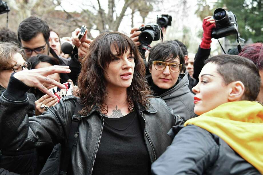 Italian actress Asia Argento and Rose McGowan, right, who both accuse Harvey Weinstein of sexual assault, take part in a #MeToo march in December 2018. Argento denied on Aug 21, 2018, having had a sexual relationship five years ago with an underage teen. Photo: ALBERTO PIZZOLI, Contributor / AFP/Getty Images / AFP or licensors