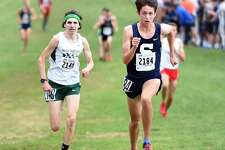 Benjamin Seiple, right, of Staples, and Eli Nahom, left, of New Milford, placed fourth and fifth respectively in the CIAC Fall Championship Boys Cross Country race in Manchester in 2017.