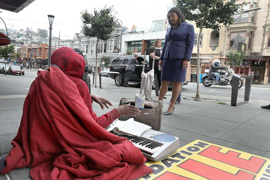 SF Mayor London Breed talks with a homeless man in front of Outfit on Castro Street as she takes a neighborhood walk this morning on Monday, Aug. 13, 2018 in San Francisco, Calif. Photo: Liz Hafalia / The Chronicle